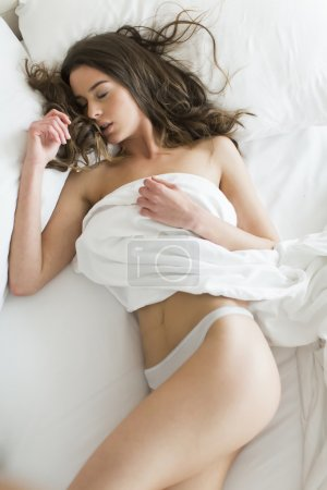 Attractive woman in the bed