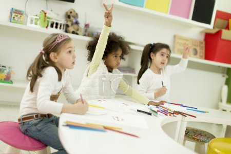 Photo for Multiracial children drawing in the playroom - Royalty Free Image
