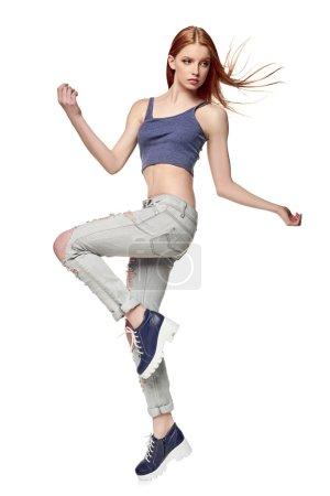 Hip-hop style teenage girl jumping dancing