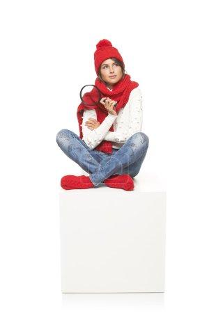 Winter woman sitting on blank billboard placard sign