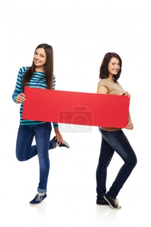 Two girl friends with red banner