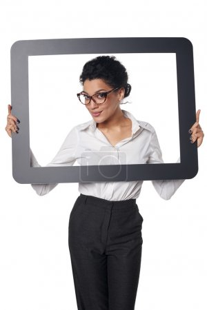 Smiling business woman looking through frame