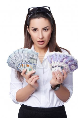 Business woman holding British pounds and US dollars