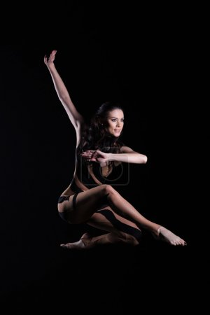 Beautiful young  dancer jumping in studio