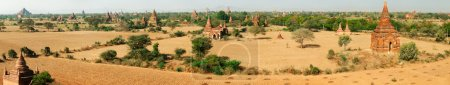 Photo for Ancient pagodas in Bagan, blue sky in background - panoramic image - Royalty Free Image