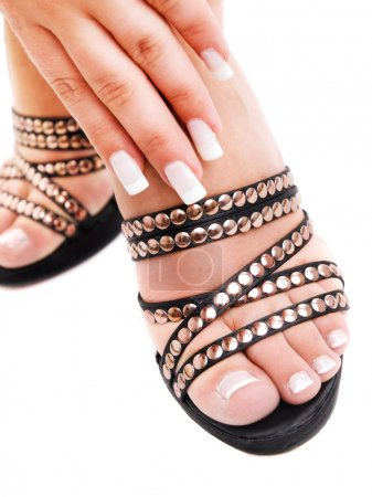 Photo pour Young woman's hand and foot with manicure and pedicure - image libre de droit