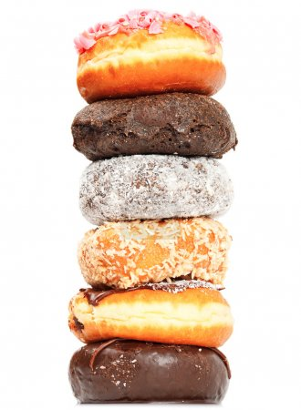Photo for Close up of pile of donuts, viewed form above - Royalty Free Image
