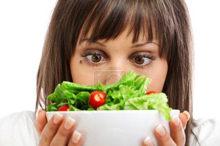 woman preparing healhty salad