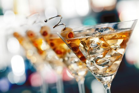 Photo for Several glasses of famous cocktail Martini, shot at a bar - Royalty Free Image