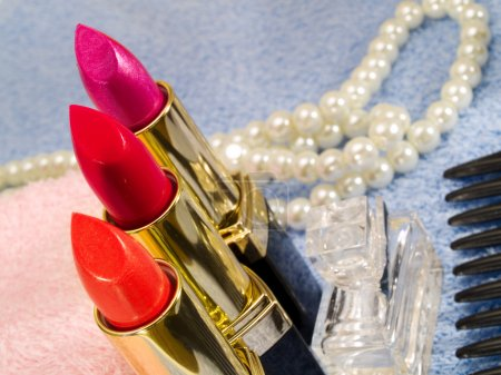 Lipsticks and pearl close-up