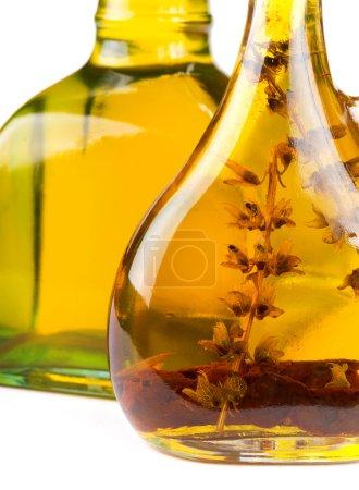 Olive oil in bottle close-up