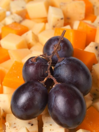 Cheese with blue grapes