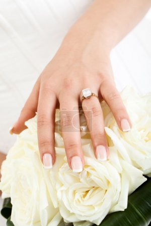 hand over white roses