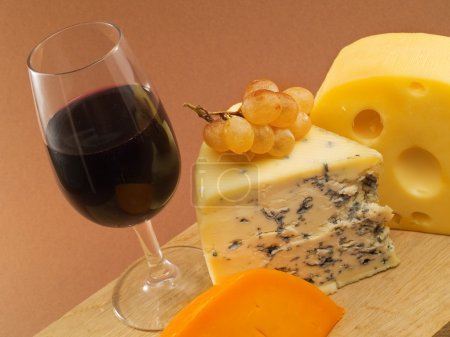 Cheese still life on background