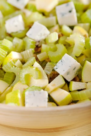 Photo for Salad with celery, apple and blue cheese in large salad bowl, ready to be served - Royalty Free Image