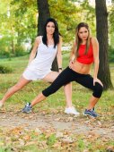 Two young women exercising