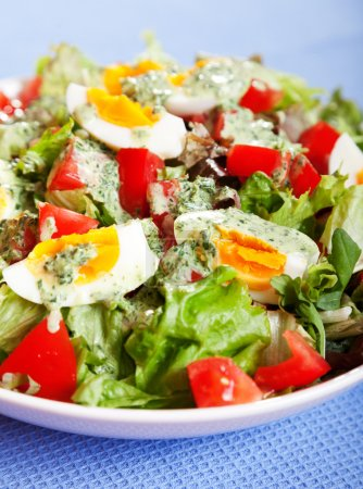 Photo for Summer salad with tomatoes and boiled eggs and creamy dressing - Royalty Free Image