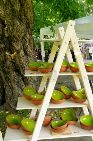 green clay pottery plates at the fair of artisans in Riga