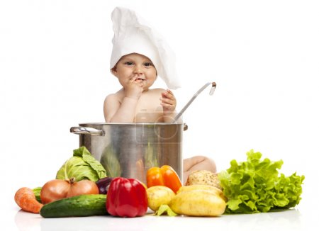 Photo for Little boy in chef's hat with saucepan and different vegetables isolated on white background - Royalty Free Image