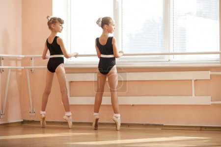 Young ballerinas standing on pointes