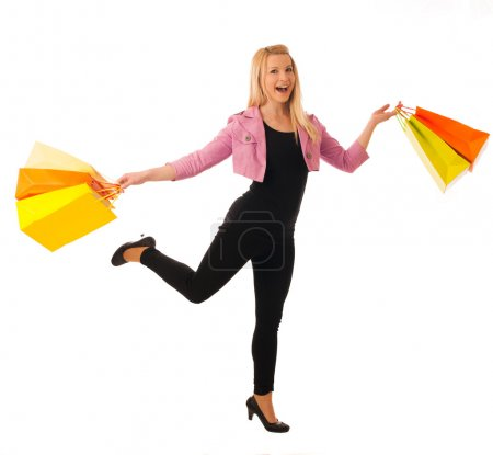 Cute blonde woman with shopping vibrant bags isolated over white