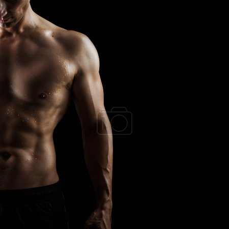 muscular handsome sexy guy on black background