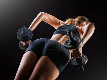 fitness woman's back and buttocks. Train - squat with dumbbells