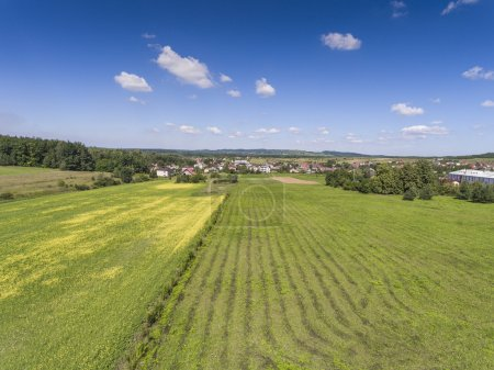 Rural landscape with green hill and blue sky in Poland. View fro