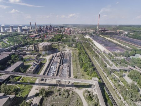 Steel factory with smokestacks at sunny day.Metallurgical plant.