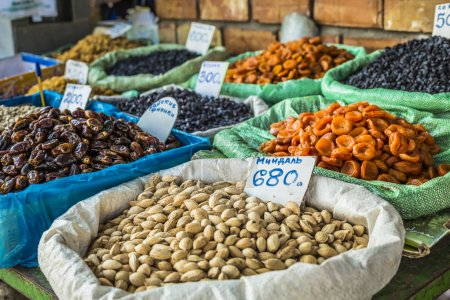 Photo for Dry fruits and spices like cashews, raisins, cloves, anise, etc. on display for sale in a bazaar in Osh Kyrgyzstan. - Royalty Free Image