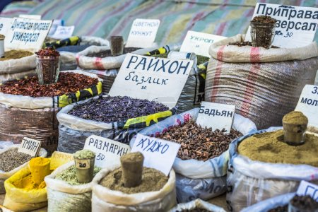 Vivid oriental central asian market with bags full of various sp