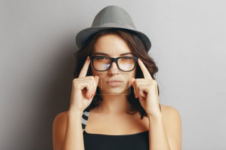 Photo for Beautiful, naturall girl in a hat and glasses. - Royalty Free Image