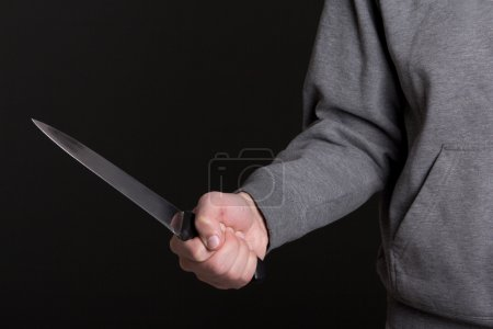 Photo for Close up of knife in male hand over grey background - Royalty Free Image