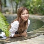 Asian female smile pool...