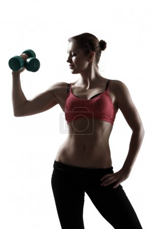 Sport woman doing exercise with dumbbells