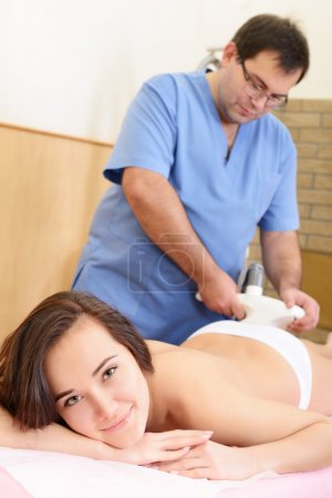Woman getting  anticellulite therapy
