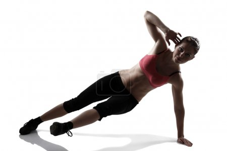 Sport woman doing abs and legs exercise