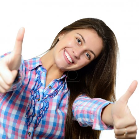 Foto de Retrato de una muchacha adolescente hermoso, seguro y alegre mostrando pulgares arriba aisladas en blanco - Imagen libre de derechos