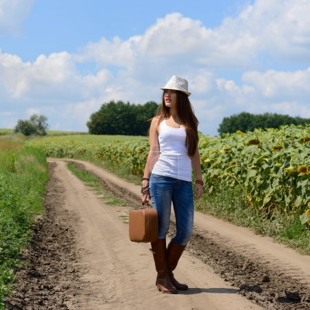 Photo for Young woman with retro suitcase traveling in countryside, summer nature outdoor - Royalty Free Image