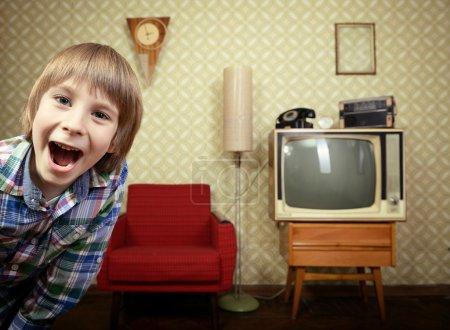Little boy in vintage room