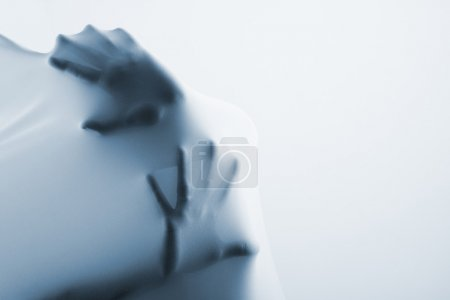 Abstract hands, human arm inside fabric