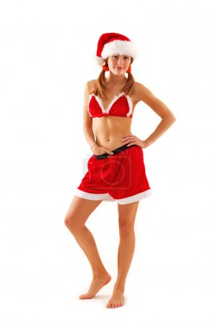 Photo for Young sexy christmas woman like santa, full length studio portrait over white background - Royalty Free Image