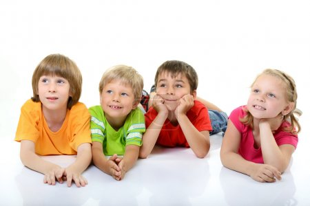 Cute children in colored t-shirts lying and smilin...