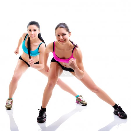 Fitness girls over white background