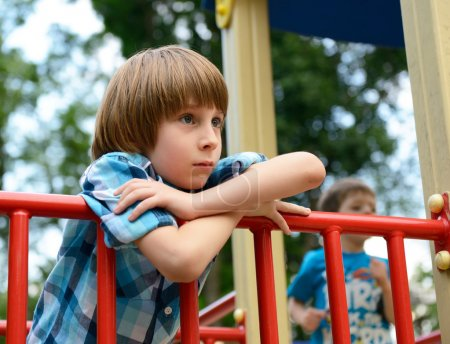 Photo for Kid playing on  playground in summer outdoor park - Royalty Free Image