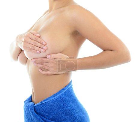 Woman  examining her breast of mastopathy
