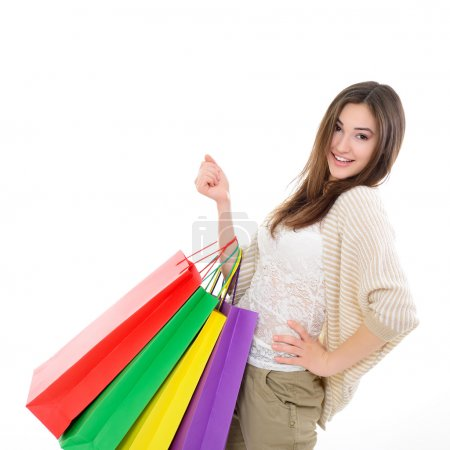 Photo for Beautiful happy girl shopaholic with colored shopping bags, over white - Royalty Free Image