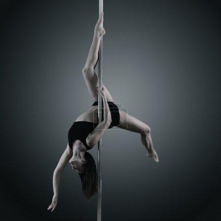 Woman dancing on pylon