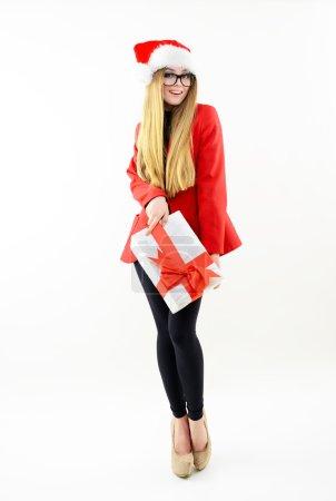 girl in  Santa's hat with gift box