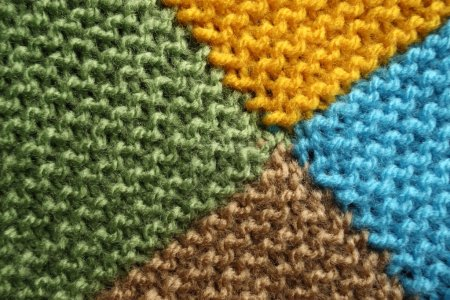 Photo for Knitted blanket macro. Four colors - Royalty Free Image